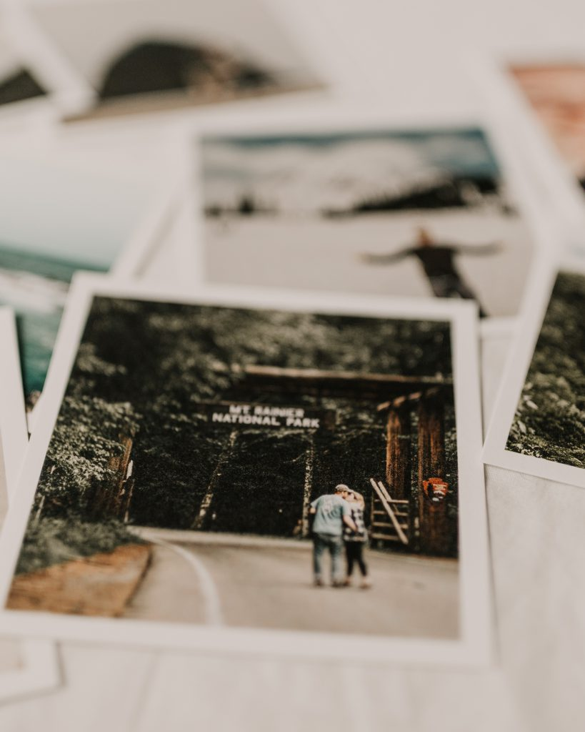 Photo prints stacked on table