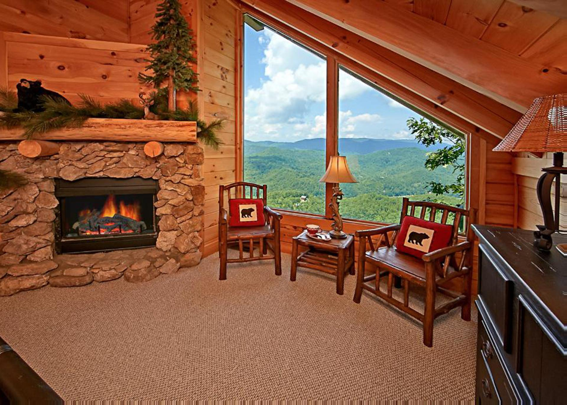 Sitting area in the master with views and a fire place!