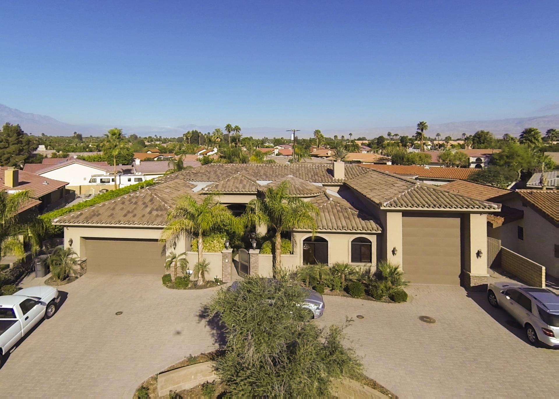 This Amazing 5 Bedroom 5 Bath Tropical Oasis Located In The Beautiful Desert Community Of