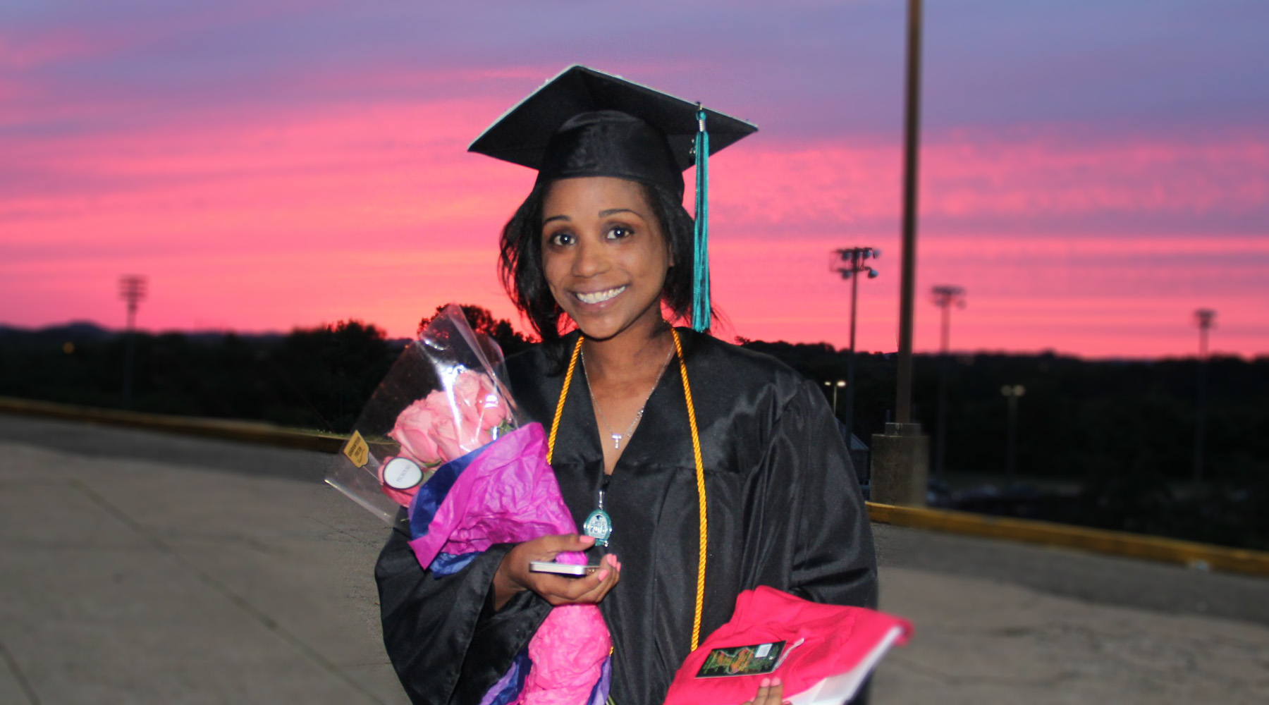 Graduate Holds Flowers After Graduation