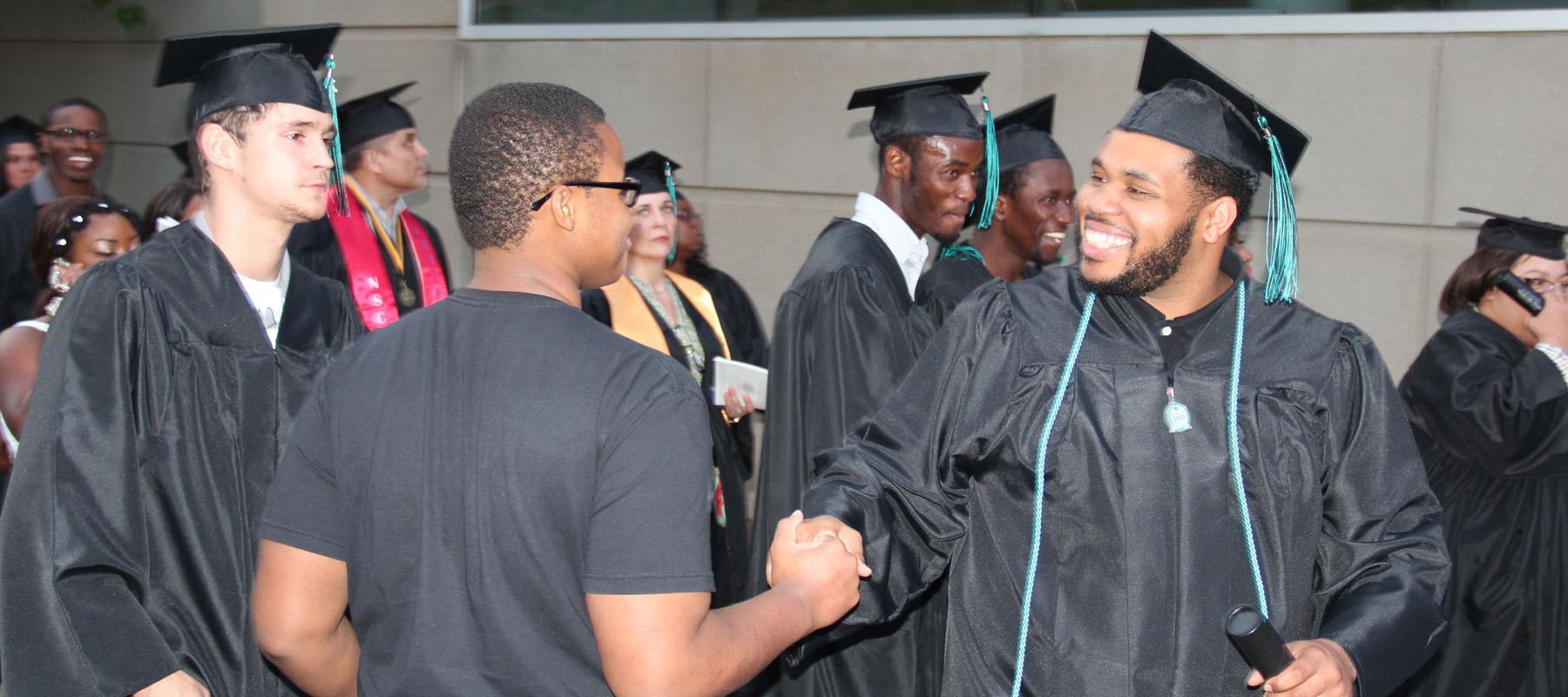 Graduate Shakes Hand