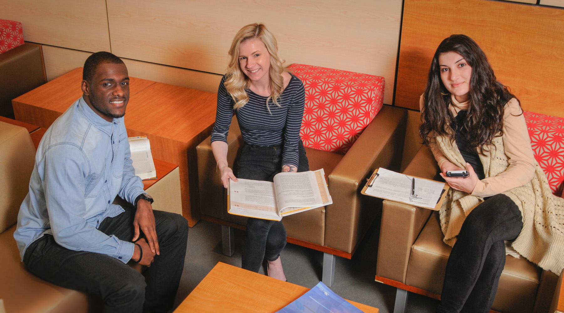 3 Students Sitting In A Study Area In The H Bldg