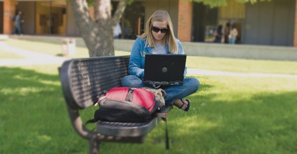Online Student Studying Outside