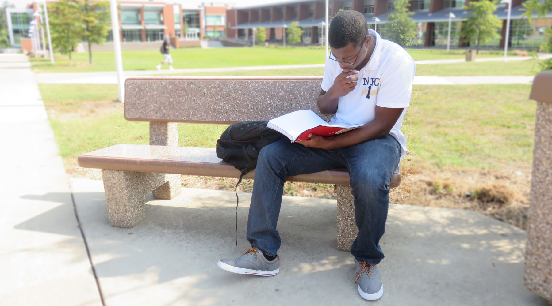 Student Studying On Main Campus In Quad Area