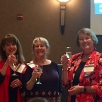 Committee members Brenda, Rhonda and Lesley toasting to our 10th successful symposium.