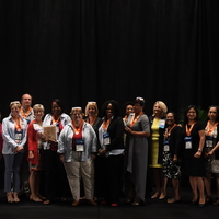 Board of Directors and chapter members at recognition ceremony at NTI in Houston.