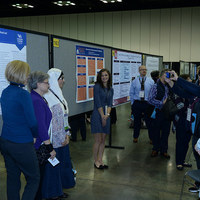 "Thompson Forbes III, pictured center, right, poster presentation, titled ""A Grounded Theory Study to Understand Nurse and Resident Physician Communication Dynamics"""