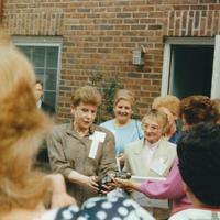 NEAOHN President Shirley Davis looks on as sculpture is presented to Matilda Babbitz.  Former AAOHN Regional Director Irene Petrie in background.