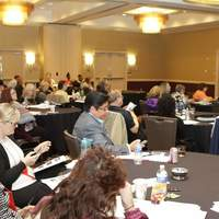 Listening intently to amazing speakers at Spring conference.
