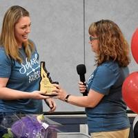 Nurse Erin Dever receives her SNOTY plaque from CDA Lead Nurse, Nichole Piekarski.