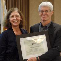 CECRAOHN President Barbara Burgel presenting to Dr David Rempel a certificate of appreciation