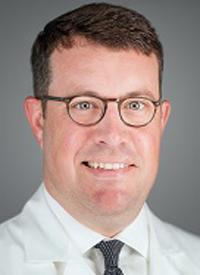 John E. Mullinax, MD