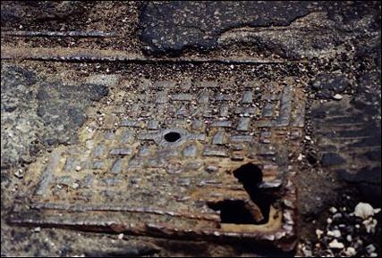 tracksbroadway-plate-manhole.jpg