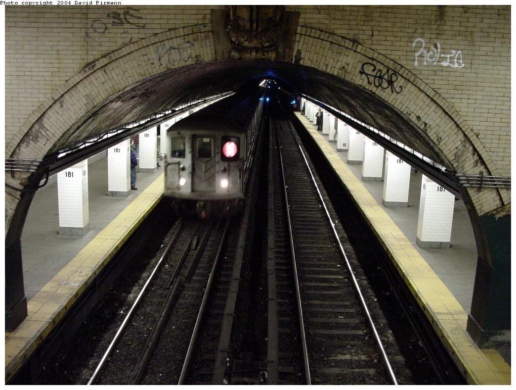 (145k, 1044x788)<br><b>Country:</b> United States<br><b>City:</b> New York<br><b>System:</b> New York City Transit<br><b>Line:</b> IRT West Side Line<br><b>Location:</b> 181st Street <br><b>Route:</b> 1<br><b>Photo by:</b> David Pirmann<br><b>Date:</b> 3/12/2000<br><b>Notes:</b> View of station from crossover facing north<br><b>Viewed (this week/total):</b> 0 / 3304