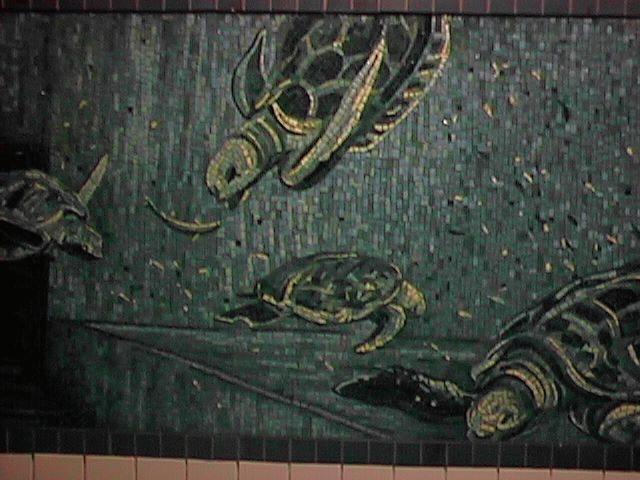 (53k, 640x480)<br><b>Country:</b> United States<br><b>City:</b> New York<br><b>System:</b> New York City Transit<br><b>Line:</b> IRT West Side Line<br><b>Location:</b> Houston Street <br><b>Photo by:</b> Joe Papa<br><b>Date:</b> 1997<br><b>Artwork:</b> <i>Platform Diving</i>, Deborah Brown (1994).<br><b>Notes:</b> Turtles Ride for Free panel.<br><b>Viewed (this week/total):</b> 2 / 4579