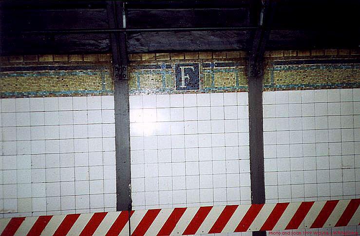 (72k, 739x484)<br><b>Country:</b> United States<br><b>City:</b> New York<br><b>System:</b> New York City Transit<br><b>Line:</b> IRT West Side Line<br><b>Location:</b> Fulton Street <br><b>Photo by:</b> Wayne Whitehorne<br><b>Date:</b> 2/27/1999<br><b>Notes:</b> Trackway wall tile<br><b>Viewed (this week/total):</b> 0 / 3699