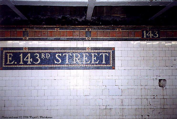 (100k, 742x499)<br><b>Country:</b> United States<br><b>City:</b> New York<br><b>System:</b> New York City Transit<br><b>Line:</b> IRT Pelham Line<br><b>Location:</b> East 143rd Street <br><b>Photo by:</b> Wayne Whitehorne<br><b>Date:</b> 9/30/1998<br><b>Notes:</b> Station name tablet<br><b>Viewed (this week/total):</b> 3 / 3449