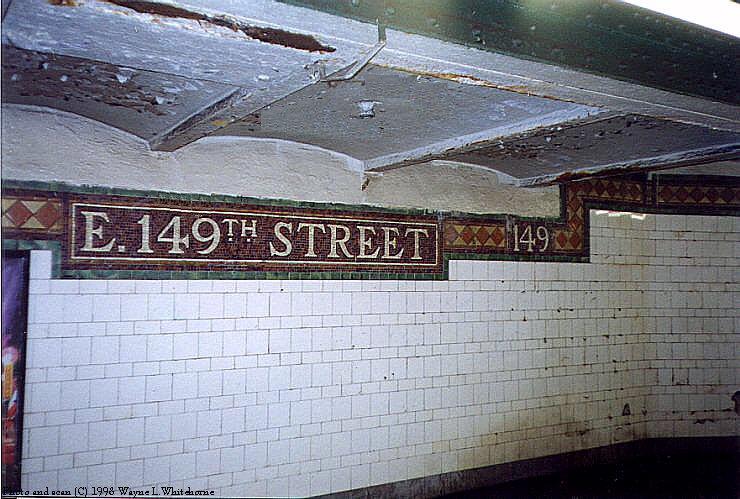 (98k, 740x499)<br><b>Country:</b> United States<br><b>City:</b> New York<br><b>System:</b> New York City Transit<br><b>Line:</b> IRT Pelham Line<br><b>Location:</b> East 149th Street <br><b>Photo by:</b> Wayne Whitehorne<br><b>Date:</b> 10/3/1998<br><b>Notes:</b> Station name tablet and climbing frieze-Vickers<br><b>Viewed (this week/total):</b> 0 / 3330