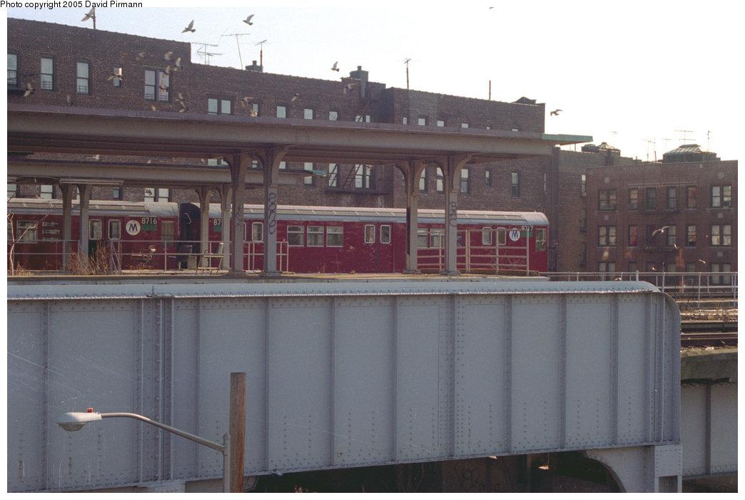 (152k, 1044x702)<br><b>Country:</b> United States<br><b>City:</b> New York<br><b>System:</b> New York City Transit<br><b>Location:</b> East 180th Street Yard<br><b>Car:</b> R-29 (St. Louis, 1962) 8717 <br><b>Photo by:</b> David Pirmann<br><b>Date:</b> 12/16/1995<br><b>Notes:</b> R29 cars stored in NYW&B platforms<br><b>Viewed (this week/total):</b> 1 / 4525