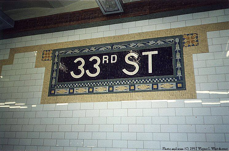 (95k, 745x491)<br><b>Country:</b> United States<br><b>City:</b> New York<br><b>System:</b> New York City Transit<br><b>Line:</b> IRT East Side Line<br><b>Location:</b> 33rd Street <br><b>Photo by:</b> Wayne Whitehorne<br><b>Date:</b> 11/28/1997<br><b>Notes:</b> Tile name tablet, Heins & LaFarge/John H. Parry Co., 1904. Original design element, Contract 1 IRT.<br><b>Viewed (this week/total):</b> 1 / 3794