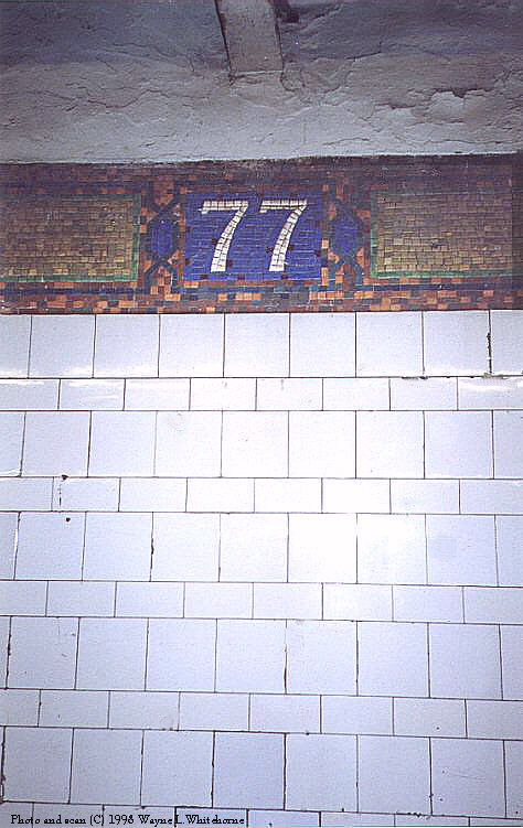 (77k, 474x751)<br><b>Country:</b> United States<br><b>City:</b> New York<br><b>System:</b> New York City Transit<br><b>Line:</b> IRT East Side Line<br><b>Location:</b> 77th Street <br><b>Photo by:</b> Wayne Whitehorne<br><b>Date:</b> 10/3/1998<br><b>Notes:</b> Mosaic icon detail<br><b>Viewed (this week/total):</b> 3 / 3327