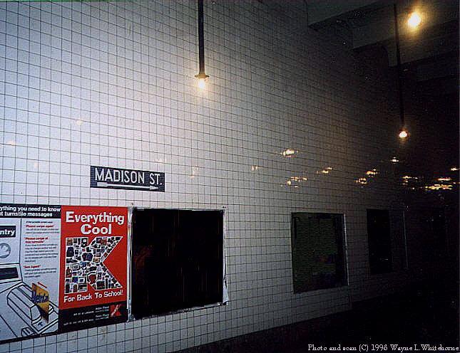 (79k, 645x496)<br><b>Country:</b> United States<br><b>City:</b> New York<br><b>System:</b> New York City Transit<br><b>Line:</b> IND 6th Avenue Line<br><b>Location:</b> East Broadway <br><b>Photo by:</b> Wayne Whitehorne<br><b>Date:</b> 8/21/1998<br><b>Notes:</b> Mezzanine with incandescent light-East Broadway IND station<br><b>Viewed (this week/total):</b> 1 / 4571