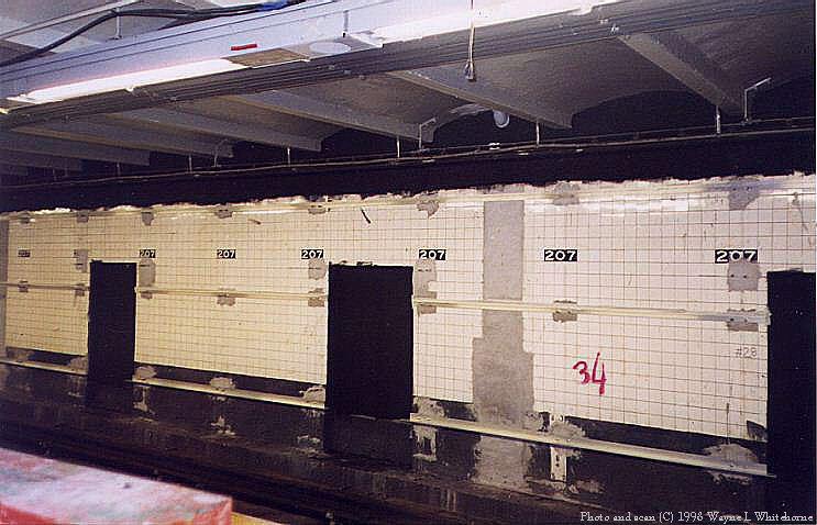 (72k, 743x478)<br><b>Country:</b> United States<br><b>City:</b> New York<br><b>System:</b> New York City Transit<br><b>Line:</b> IND 8th Avenue Line<br><b>Location:</b> 207th Street <br><b>Route:</b> A<br><b>Photo by:</b> Wayne Whitehorne<br><b>Date:</b> 12/19/1998<br><b>Notes:</b> Trackside wall being prepared for new tile<br><b>Viewed (this week/total):</b> 3 / 3920