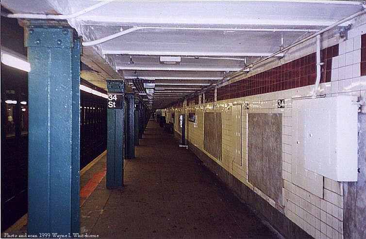 (72k, 754x493)<br><b>Country:</b> United States<br><b>City:</b> New York<br><b>System:</b> New York City Transit<br><b>Line:</b> IND 8th Avenue Line<br><b>Location:</b> 34th Street/Penn Station <br><b>Photo by:</b> Wayne Whitehorne<br><b>Date:</b> 8/14/1999<br><b>Notes:</b> Wall name tablet<br><b>Viewed (this week/total):</b> 3 / 3788