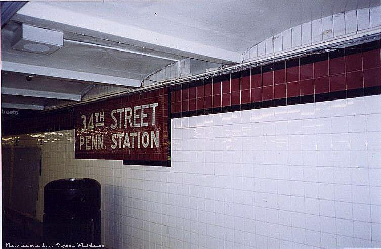 (62k, 753x493)<br><b>Country:</b> United States<br><b>City:</b> New York<br><b>System:</b> New York City Transit<br><b>Line:</b> IND 8th Avenue Line<br><b>Location:</b> 34th Street/Penn Station <br><b>Photo by:</b> Wayne Whitehorne<br><b>Date:</b> 8/14/1999<br><b>Notes:</b> New wall tile<br><b>Viewed (this week/total):</b> 4 / 2839