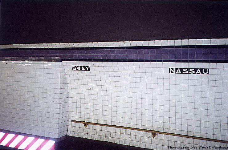 (77k, 740x487)<br><b>Country:</b> United States<br><b>City:</b> New York<br><b>System:</b> New York City Transit<br><b>Line:</b> IND 8th Avenue Line<br><b>Location:</b> Fulton Street (Broadway/Nassau) <br><b>Photo by:</b> Wayne Whitehorne<br><b>Date:</b> 8/14/1999<br><b>Notes:</b> Wall tile with square inset<br><b>Viewed (this week/total):</b> 0 / 3941