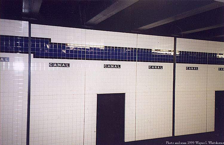 (58k, 750x488)<br><b>Country:</b> United States<br><b>City:</b> New York<br><b>System:</b> New York City Transit<br><b>Line:</b> IND 8th Avenue Line<br><b>Location:</b> Canal Street-Holland Tunnel <br><b>Photo by:</b> Wayne Whitehorne<br><b>Date:</b> 1/16/1999<br><b>Notes:</b> New wall tile<br><b>Viewed (this week/total):</b> 11 / 2983