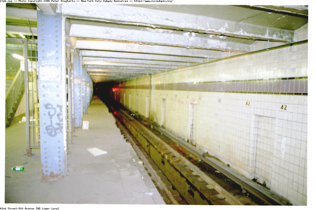 (107k, 1008x672)<br><b>Country:</b> United States<br><b>City:</b> New York<br><b>System:</b> New York City Transit<br><b>Line:</b> IND 8th Avenue Line<br><b>Location:</b> 42nd Street/Port Authority Bus Terminal (Lower Level) <br><b>Photo by:</b> Peter Dougherty<br><b>Date:</b> 1997<br><b>Notes:</b> Looking Southbound along this long-disused platform. The Southbound 8the Ave. local track is immediately above this special track, designated D3 - the same designation as the Southbound E tracks from 53rd St. The Southbound E once stopped at this platform before rising and continuing it's Southward journey, either on track A1 or A3, depending if it was in local or express service. Today the E uses a crossover just North of the station to switch to the 8th Ave local tracks. <br><b>Viewed (this week/total):</b> 1 / 21972