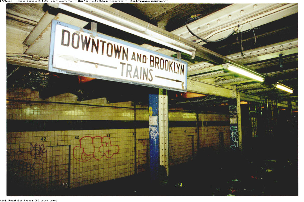 (143k, 1008x672)<br><b>Country:</b> United States<br><b>City:</b> New York<br><b>System:</b> New York City Transit<br><b>Line:</b> IND 8th Avenue Line<br><b>Location:</b> 42nd Street/Port Authority Bus Terminal (Lower Level) <br><b>Photo by:</b> Peter Dougherty<br><b>Date:</b> 1997<br><b>Notes:</b> Close-up of another old-style TA sign. It is believed there was once, long ago, a passageway from the uptown platform to this lower-level platform. This sign would have greeted travelers emerging from this passageway.<br><b>Viewed (this week/total):</b> 0 / 16364
