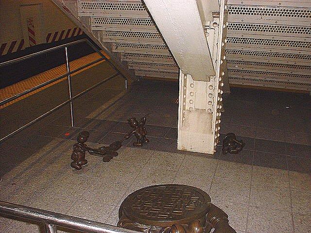 (102k, 640x480)<br><b>Country:</b> United States<br><b>City:</b> New York<br><b>System:</b> New York City Transit<br><b>Line:</b> IND 8th Avenue Line<br><b>Location:</b> 14th Street <br><b>Photo by:</b> Peggy Darlington<br><b>Date:</b> 2000<br><b>Artwork:</b> <i>Life Underground</i>, Tom Otterness (2000).<br><b>Viewed (this week/total):</b> 1 / 3296