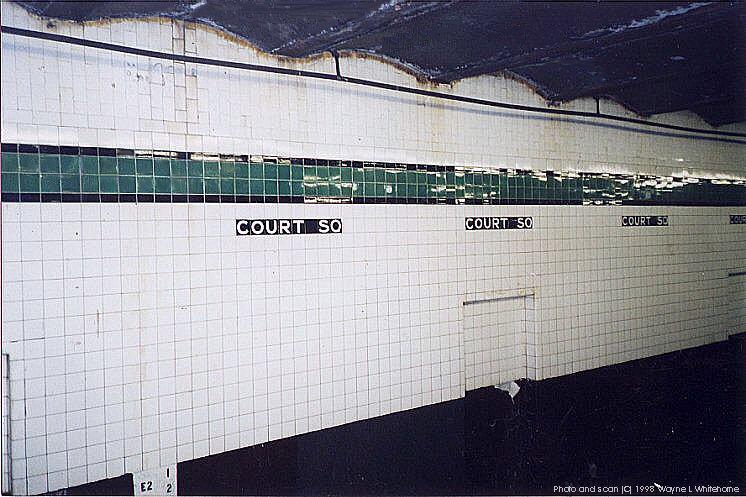 (89k, 746x497)<br><b>Country:</b> United States<br><b>City:</b> New York<br><b>System:</b> New York City Transit<br><b>Line:</b> IND Crosstown Line<br><b>Location:</b> Court Square <br><b>Photo by:</b> Wayne Whitehorne<br><b>Date:</b> 4/18/1998<br><b>Notes:</b> Wall tile<br><b>Viewed (this week/total):</b> 6 / 3351