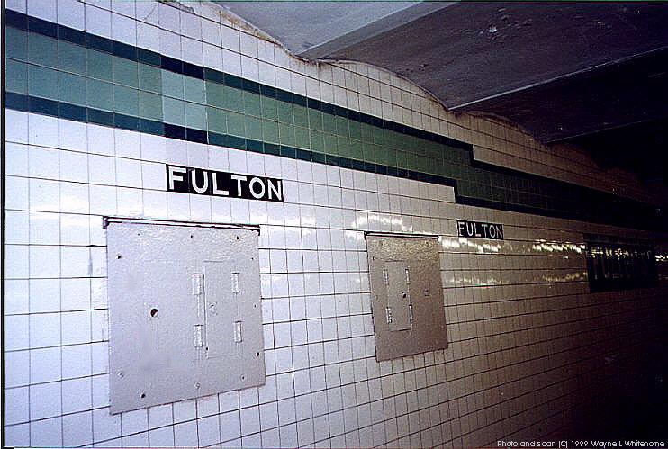 (92k, 742x499)<br><b>Country:</b> United States<br><b>City:</b> New York<br><b>System:</b> New York City Transit<br><b>Line:</b> IND Crosstown Line<br><b>Location:</b> Fulton Street <br><b>Photo by:</b> Wayne Whitehorne<br><b>Date:</b> 1/28/1999<br><b>Notes:</b> Wall tile<br><b>Viewed (this week/total):</b> 6 / 3418