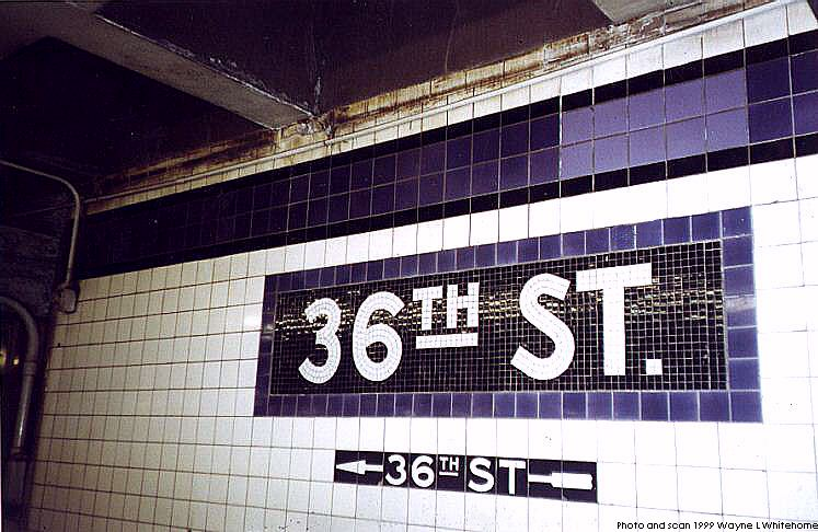 (80k, 747x486)<br><b>Country:</b> United States<br><b>City:</b> New York<br><b>System:</b> New York City Transit<br><b>Line:</b> IND Queens Boulevard Line<br><b>Location:</b> 36th Street <br><b>Photo by:</b> Wayne Whitehorne<br><b>Date:</b> 12/11/1999<br><b>Notes:</b> Tablet and wall tile with patched section<br><b>Viewed (this week/total):</b> 1 / 3046