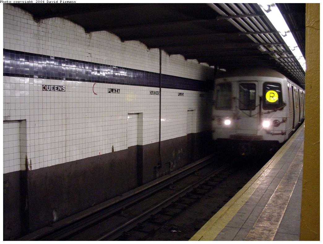 (116k, 1044x788)<br><b>Country:</b> United States<br><b>City:</b> New York<br><b>System:</b> New York City Transit<br><b>Line:</b> IND Queens Boulevard Line<br><b>Location:</b> Queens Plaza <br><b>Route:</b> R<br><b>Car:</b> R-46 (Pullman-Standard, 1974-75)  <br><b>Photo by:</b> David Pirmann<br><b>Date:</b> 1/14/2001<br><b>Notes:</b> Black Grape wall tile<br><b>Viewed (this week/total):</b> 3 / 8214