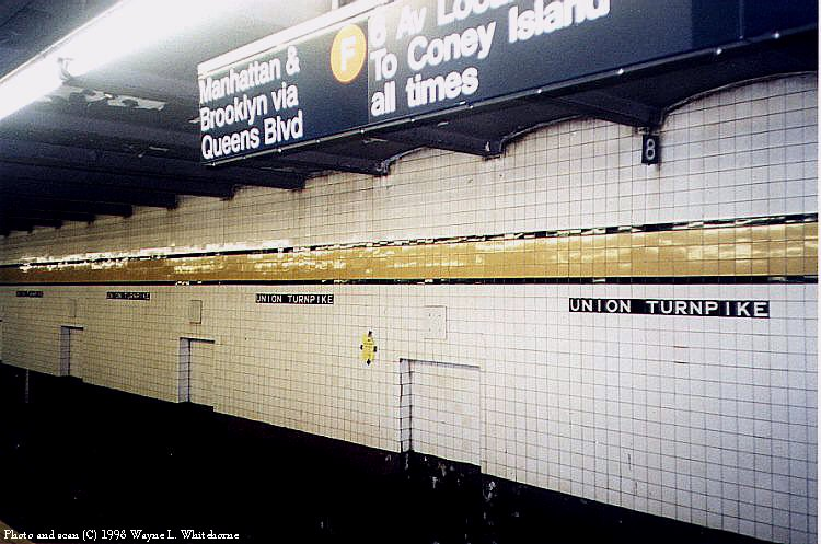 (89k, 750x497)<br><b>Country:</b> United States<br><b>City:</b> New York<br><b>System:</b> New York City Transit<br><b>Line:</b> IND Queens Boulevard Line<br><b>Location:</b> Union Turnpike/Kew Gardens <br><b>Photo by:</b> Wayne Whitehorne<br><b>Date:</b> 4/18/1998<br><b>Viewed (this week/total):</b> 0 / 3540