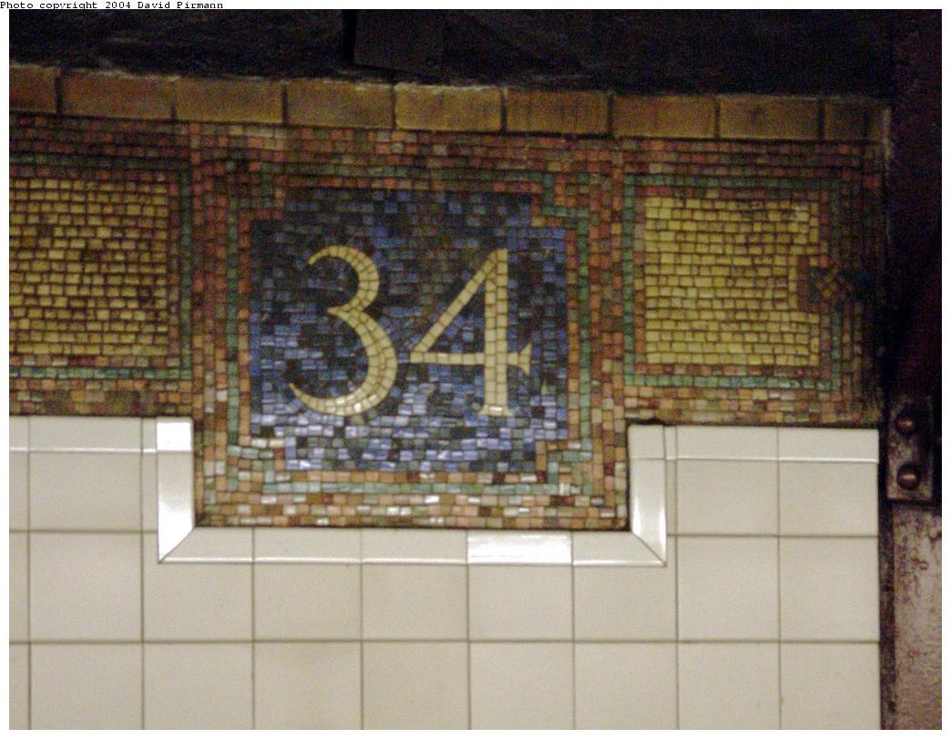 (131k, 1044x811)<br><b>Country:</b> United States<br><b>City:</b> New York<br><b>System:</b> New York City Transit<br><b>Line:</b> BMT Broadway Line<br><b>Location:</b> 34th Street/Herald Square<br><b>Photo by:</b> David Pirmann<br><b>Date:</b> 8/27/2000<br><b>Notes:</b> Renovated wall tiling and original BMT 34 monogram<br><b>Viewed (this week/total):</b> 3 / 3874