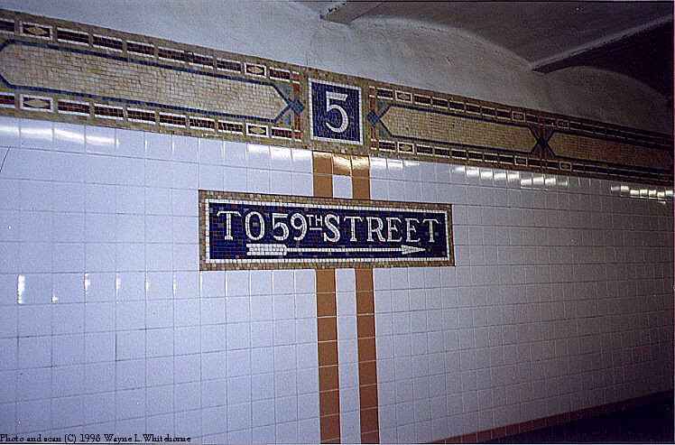 (89k, 748x493)<br><b>Country:</b> United States<br><b>City:</b> New York<br><b>System:</b> New York City Transit<br><b>Line:</b> BMT Broadway Line<br><b>Location:</b> 5th Avenue <br><b>Photo by:</b> Wayne Whitehorne<br><b>Date:</b> 9/19/1998<br><b>Notes:</b> Icon, frieze and directional sign-Vickers<br><b>Viewed (this week/total):</b> 0 / 3678
