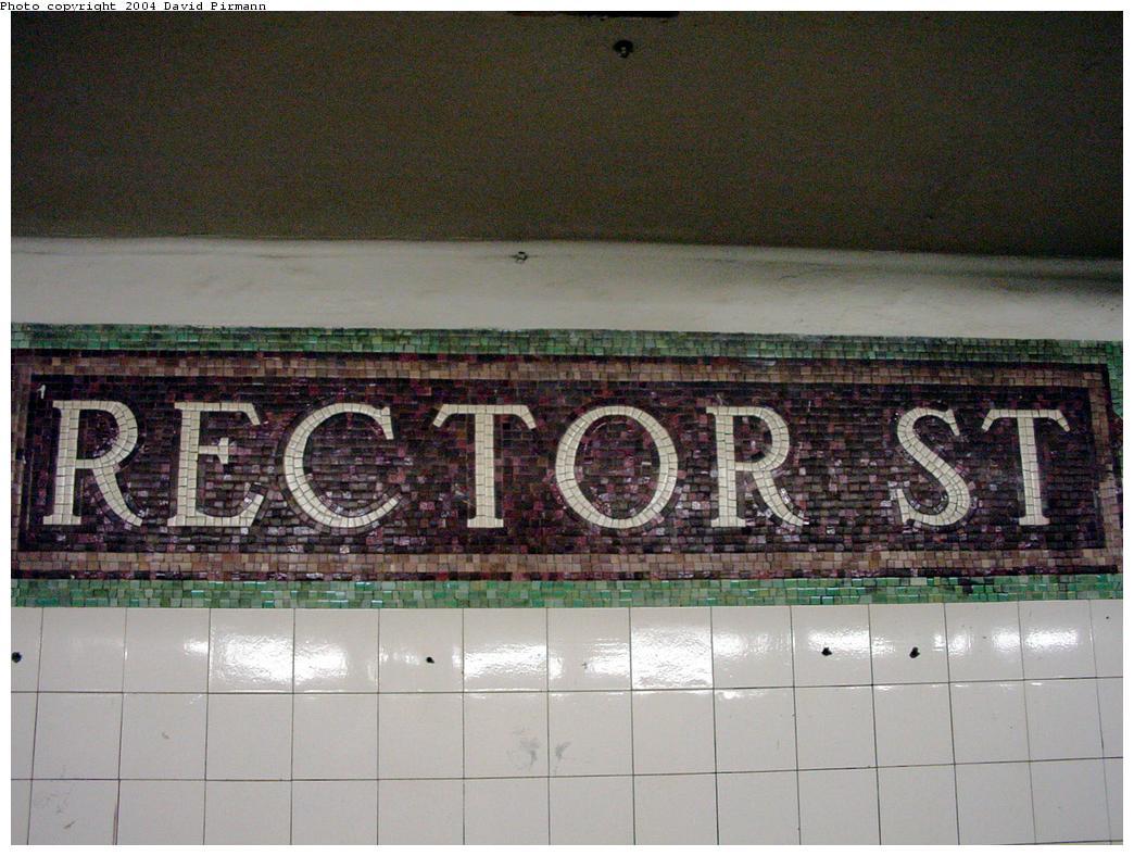 (134k, 1044x788)<br><b>Country:</b> United States<br><b>City:</b> New York<br><b>System:</b> New York City Transit<br><b>Line:</b> BMT Broadway Line<br><b>Location:</b> Rector Street <br><b>Photo by:</b> David Pirmann<br><b>Date:</b> 8/27/2000<br><b>Notes:</b> Last remaining mosaic name tablet on northbound platform<br><b>Viewed (this week/total):</b> 2 / 3295