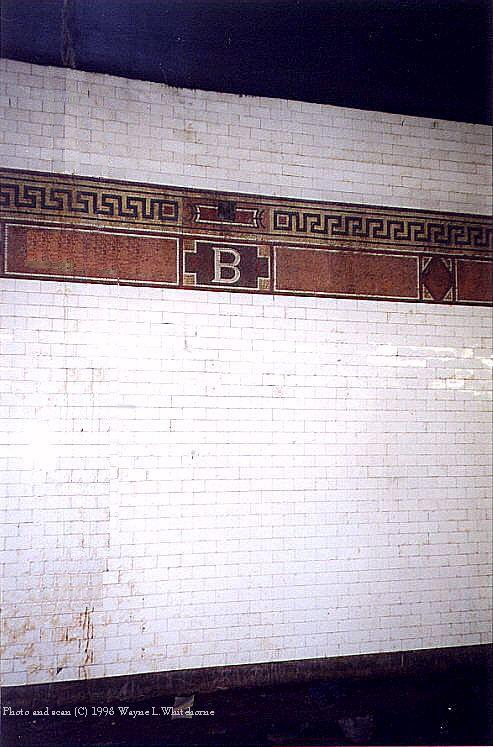 (84k, 493x747)<br><b>Country:</b> United States<br><b>City:</b> New York<br><b>System:</b> New York City Transit<br><b>Line:</b> BMT Nassau Street/Jamaica Line<br><b>Location:</b> Bowery <br><b>Photo by:</b> Wayne Whitehorne<br><b>Date:</b> 9/19/1998<br><b>Notes:</b> Grecian design mosaic icon and frieze-Vickers, 1913<br><b>Viewed (this week/total):</b> 2 / 3147