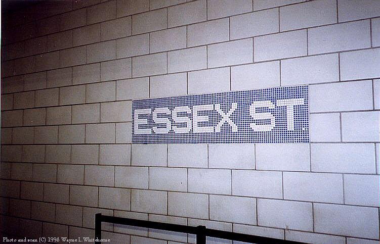 (80k, 751x483)<br><b>Country:</b> United States<br><b>City:</b> New York<br><b>System:</b> New York City Transit<br><b>Line:</b> BMT Nassau Street/Jamaica Line<br><b>Location:</b> Essex Street <br><b>Photo by:</b> Wayne Whitehorne<br><b>Date:</b> 9/30/1998<br><b>Notes:</b> Essex Street-new tablet in plain tile<br><b>Viewed (this week/total):</b> 0 / 3210