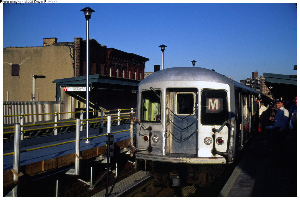 (164k, 1044x697)<br><b>Country:</b> United States<br><b>City:</b> New York<br><b>System:</b> New York City Transit<br><b>Line:</b> BMT Nassau Street/Jamaica Line<br><b>Location:</b> Marcy Avenue <br><b>Route:</b> M<br><b>Photo by:</b> David Pirmann<br><b>Date:</b> 4/30/1999<br><b>Notes:</b> M train at Marcy Avenue<br><b>Viewed (this week/total):</b> 0 / 2800
