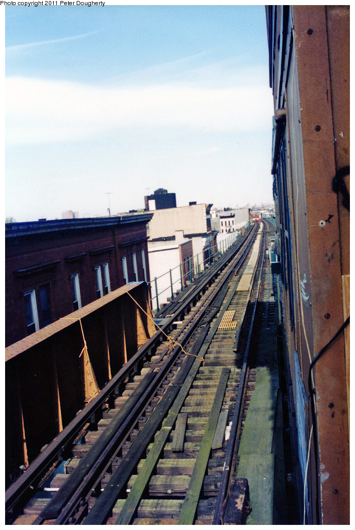 (376k, 699x1044)<br><b>Country:</b> United States<br><b>City:</b> New York<br><b>System:</b> New York City Transit<br><b>Line:</b> BMT Myrtle Avenue Line<br><b>Location:</b> Broadway/Myrtle Avenue (Upper Level) <br><b>Photo by:</b> Peter Dougherty<br><b>Notes:</b> View of southbound trackway (looking north) on upper level<br><b>Viewed (this week/total):</b> 0 / 7913