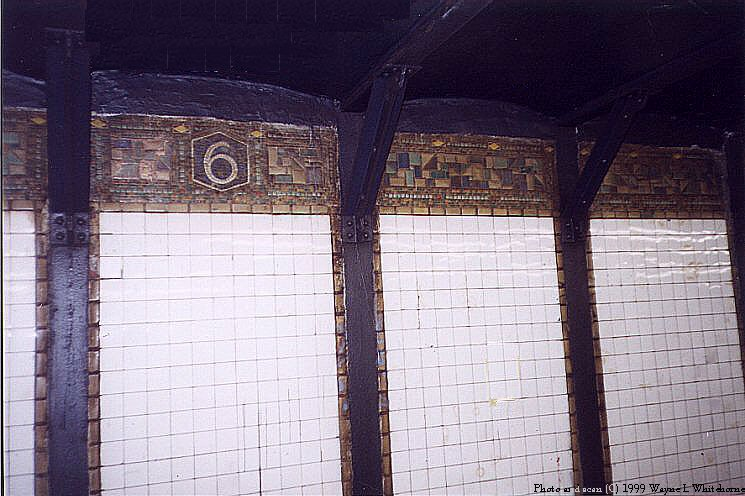(84k, 745x496)<br><b>Country:</b> United States<br><b>City:</b> New York<br><b>System:</b> New York City Transit<br><b>Line:</b> BMT Canarsie Line<br><b>Location:</b> 6th Avenue <br><b>Route:</b> L<br><b>Photo by:</b> Wayne Whitehorne<br><b>Date:</b> 4/24/1999<br><b>Notes:</b> Mosaic frieze and icon<br><b>Viewed (this week/total):</b> 3 / 2541