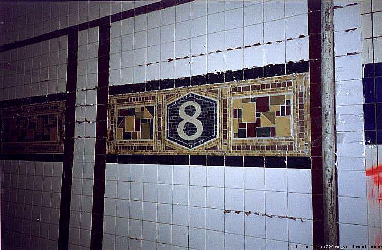 (78k, 743x486)<br><b>Country:</b> United States<br><b>City:</b> New York<br><b>System:</b> New York City Transit<br><b>Line:</b> BMT Canarsie Line<br><b>Location:</b> 8th Avenue <br><b>Route:</b> L<br><b>Photo by:</b> Wayne Whitehorne<br><b>Date:</b> 11/8/1999<br><b>Notes:</b> Closeup of new Vickers frieze<br><b>Viewed (this week/total):</b> 1 / 2255