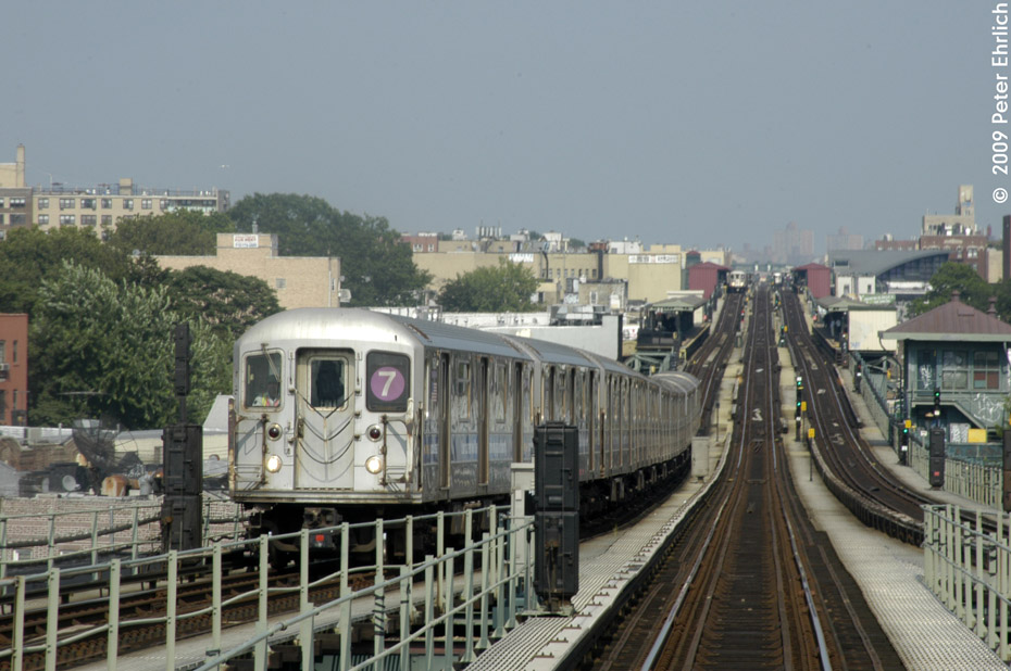 (195k, 930x618)<br><b>Country:</b> United States<br><b>City:</b> New York<br><b>System:</b> New York City Transit<br><b>Line:</b> IRT Flushing Line<br><b>Location:</b> 61st Street/Woodside <br><b>Route:</b> 7<br><b>Car:</b> R-62A (Bombardier, 1984-1987)  1680 <br><b>Photo by:</b> Peter Ehrlich<br><b>Date:</b> 7/22/2009<br><b>Notes:</b> Approaching 61st Street, inbound.  Another inbound train is visible at 74th Street.<br><b>Viewed (this week/total):</b> 1 / 1113