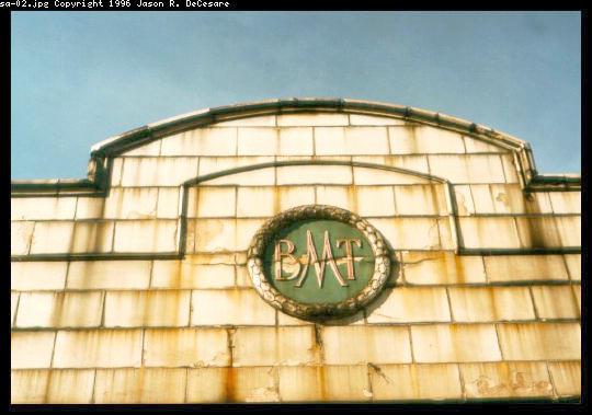 (42k, 540x379)<br><b>Country:</b> United States<br><b>City:</b> New York<br><b>System:</b> New York City Transit<br><b>Location:</b> Coney Island/Stillwell Avenue<br><b>Photo by:</b> Jason R. DeCesare<br><b>Date:</b> 1995<br><b>Notes:</b> BMT Logo<br><b>Viewed (this week/total):</b> 5 / 2104